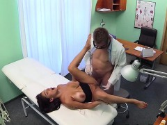 Doctor rubs huge tits of...