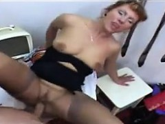 Mature Woman Giving A Footjob