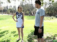 Tiny Cheerleader Jumps On A...